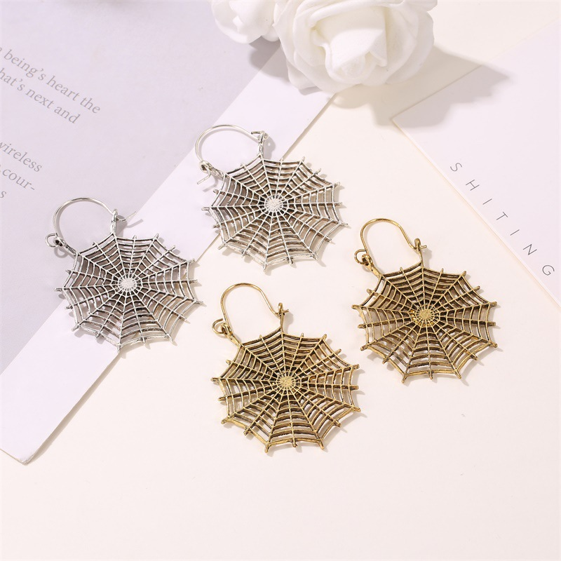 New fashion retro hollow spider web ear buckle earrings gothic exaggerated metal ear jewelry for women wholesale NHMO207800