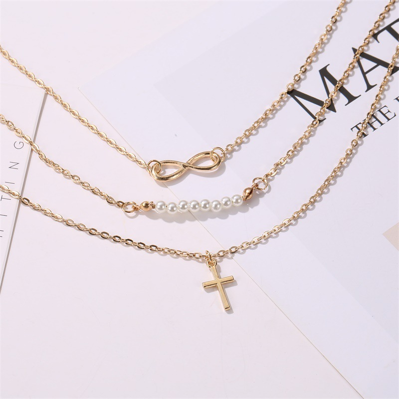 New fashion long necklace 8 word pearl multilayer necklace cross pendant necklace female clavicle chain wholesale NHMO208212