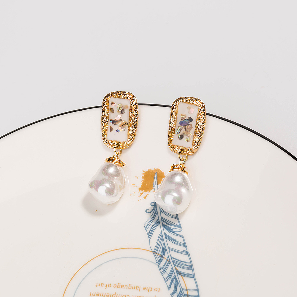 Hot selling fashion white dripping oil color shell handwoven pure white pearl earrings wholesale NHAN260452