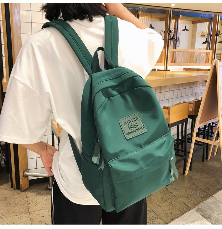 Fashion solid color high school students casual waterproof backpack HX190427119655
