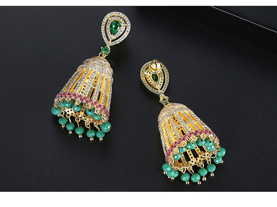 Nihaojewelry Fashion Hollow Bell Women's Copper Inlaid Zircon Stud Earrings Tassel Earrings NHTM199572