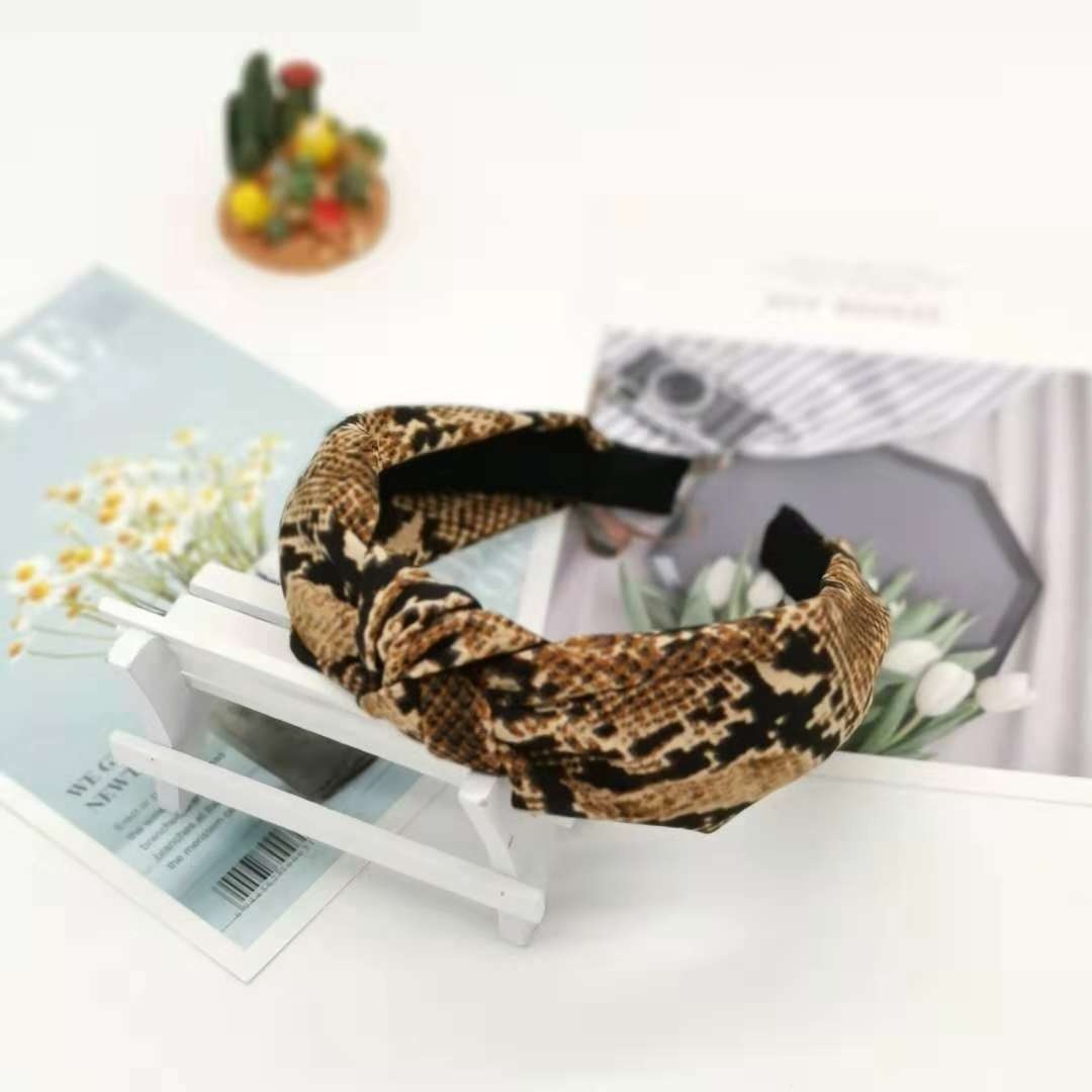 hot selling wide-brimmed snakeskin hair band headband retro cloth snake pattern hairpin bow cross hair accessories ladies wholesale nihaojewelry NHUX222347