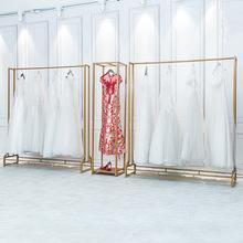 Bắc Âu rèn sắt trưng bày đám cưới sáng tạo trưng bày đám cưới đứng cô dâu cửa hàng vàng cao cấp đứng sàn quần áo Đạo cụ trưng bày quần áo