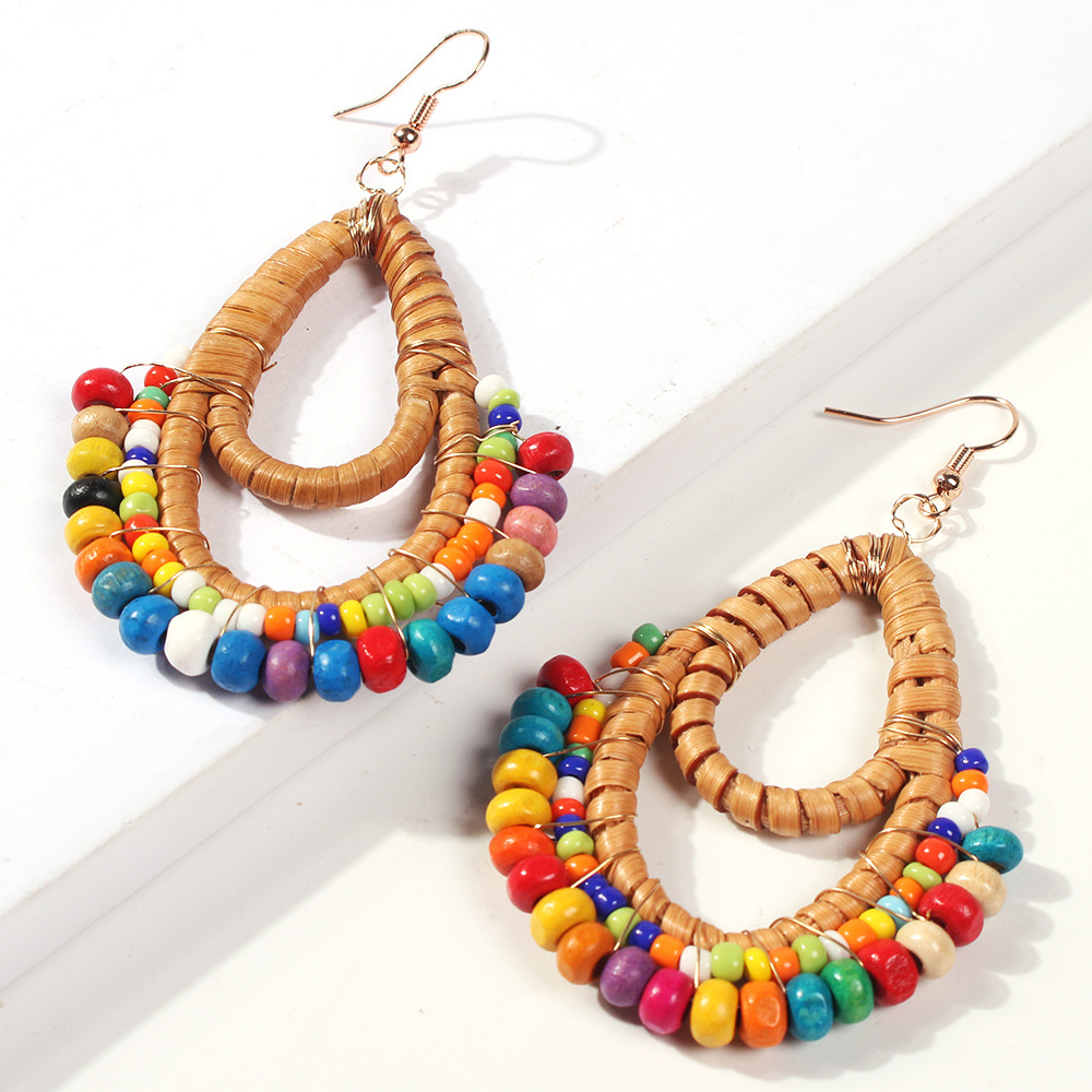 Europe and the United States selling geometric shape rattan long section of rice beads earrings NHMD133002