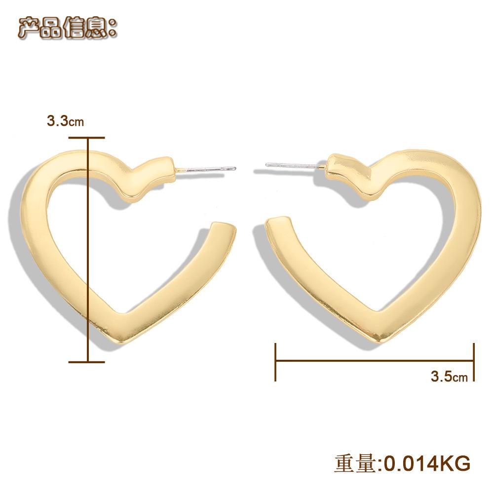 Aretes para mujer de aleación de corazón Pendientes de cara modificada Accesorios de joyería salvaje al por mayor NHJQ185868