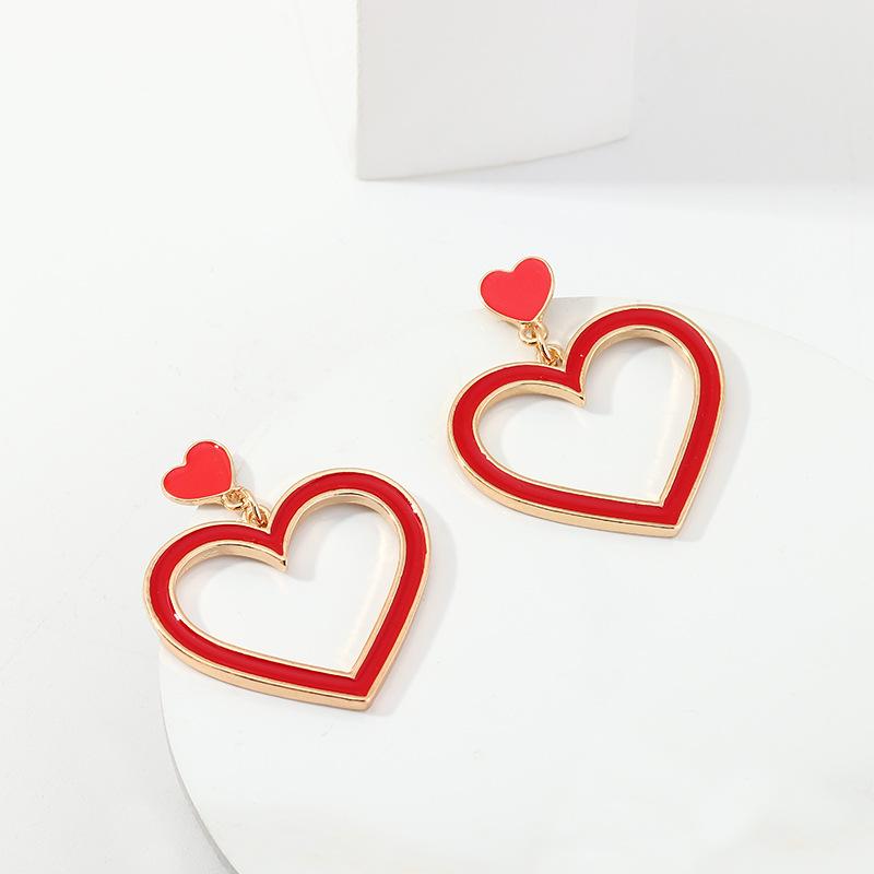 Joyería tamaño de moda al por mayor aretes de amor pendientes de corazón de nectarina de goteo de aleación NHNZ205172