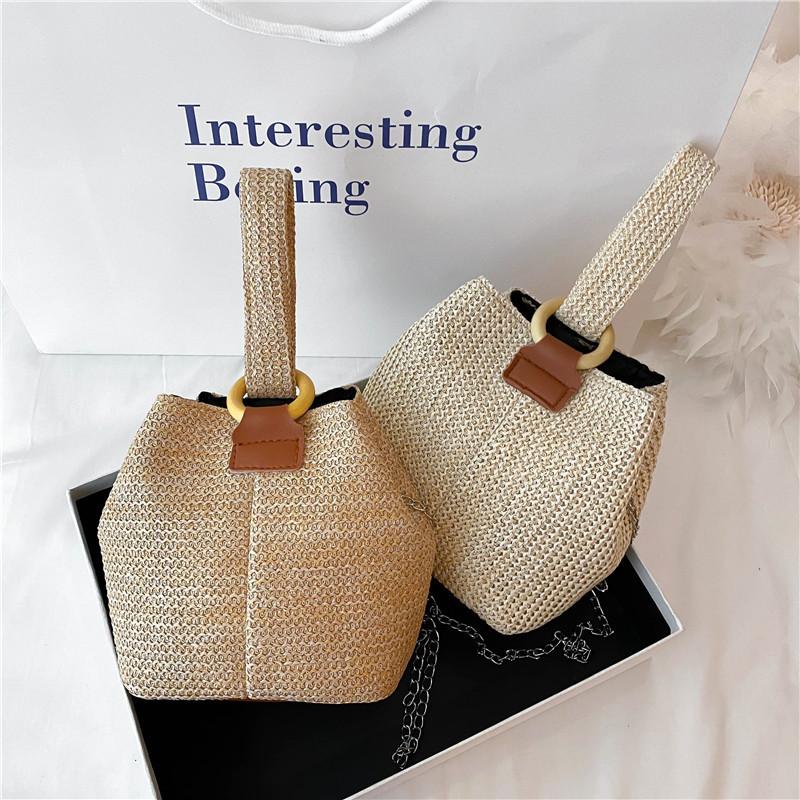 2020新款潮流斜挎水桶包小清新手提包学生编织袋森系沙滩草编包女
