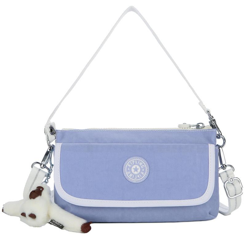 找淘宝代理女包包迷你帆布时尚手机包单肩手提包斜挎包K23431