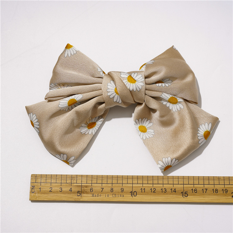 Korean small daisy knotted bow hairpin girl plate hair satin double spring clip accessories nihaojewelry wholesale  NHOF215334
