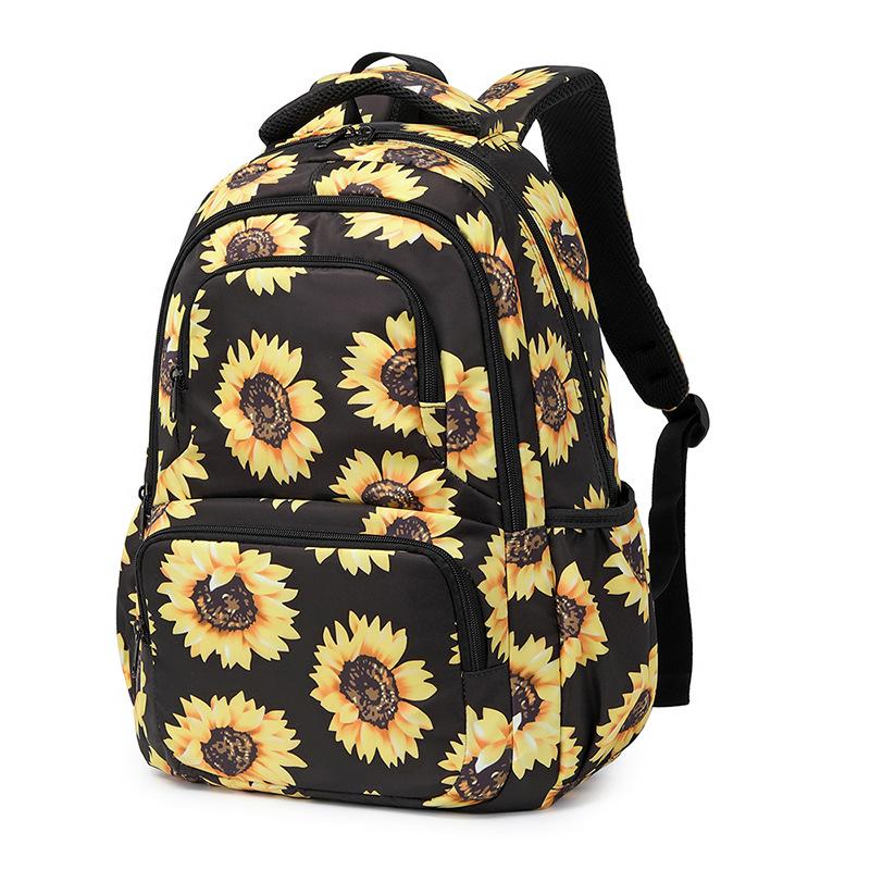 亚马逊外贸书包女小学双肩背包向日葵印花儿童包包反光条防水出口