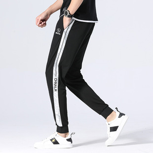 Men's casual pants spring and autumn new thin elastic stripe solid color personality fashion small feet nine-point beam pants men