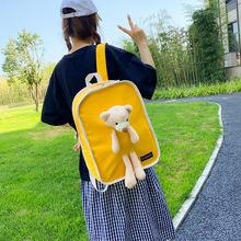 2020新款校园小清新可爱小熊挂件学生书包女简约个性帆布双肩包潮