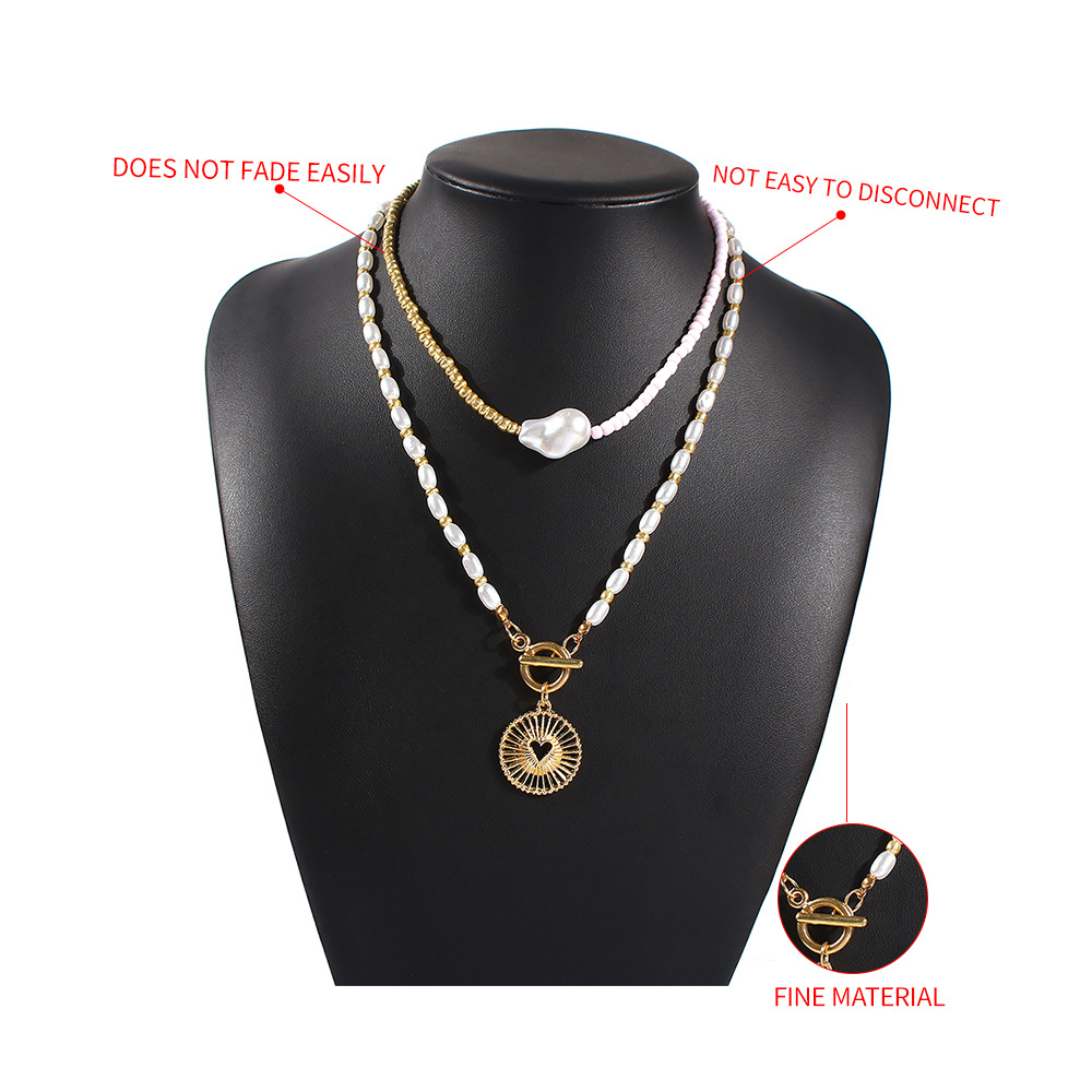 new trend jewelry creative two-color stitching pearl necklace alloy hollow pendant necklace wholesale nihaojewelry  NHMD225372