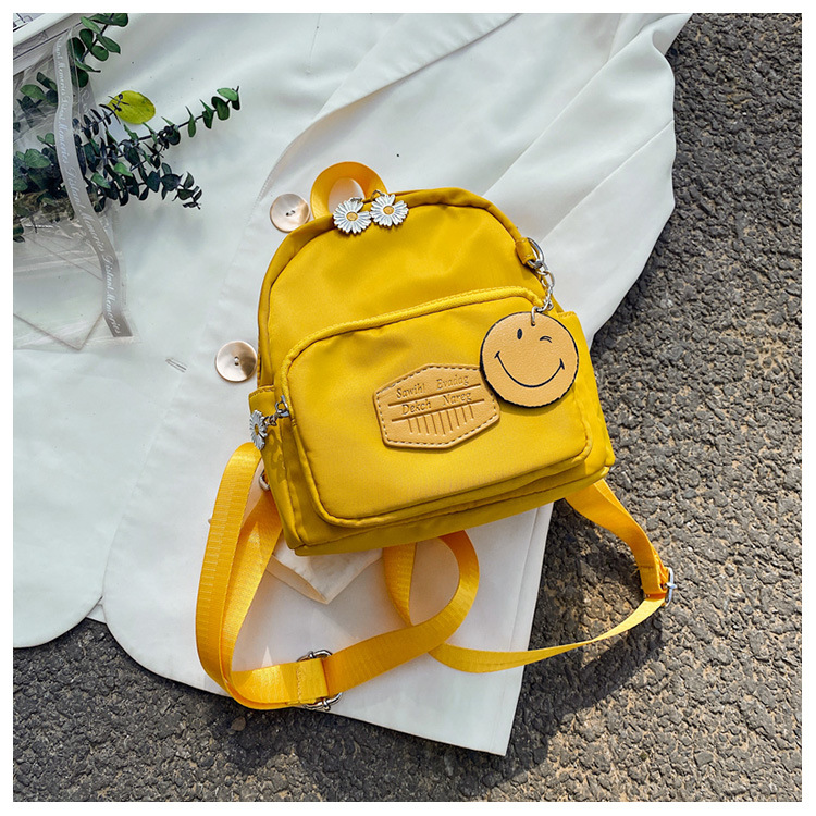 Korean cute  new wave student backpack simple Smiley daisy messenger bag backpack nihaojewelry wholesale NHTC218845