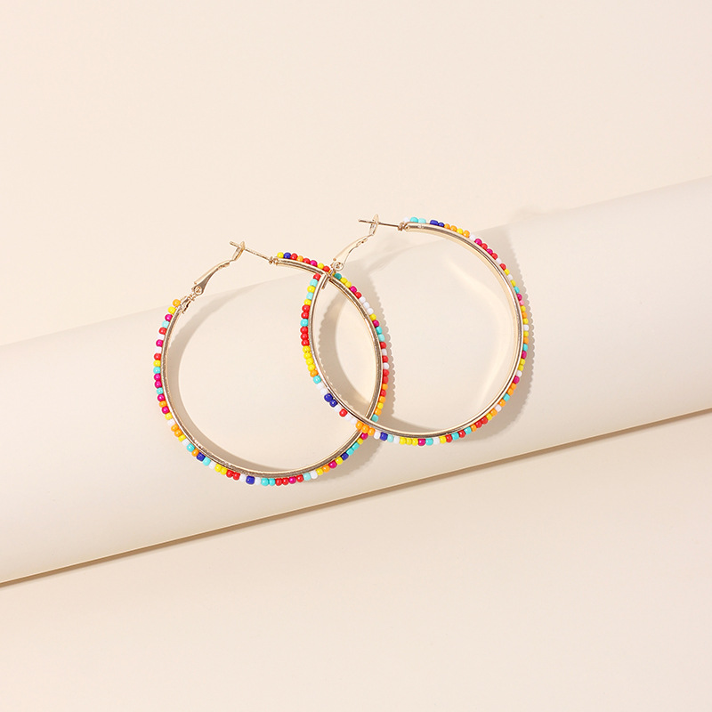 Fashion exaggerated geometric big circle ethnic style round handmade beaded rice bead earrings NHRN240959