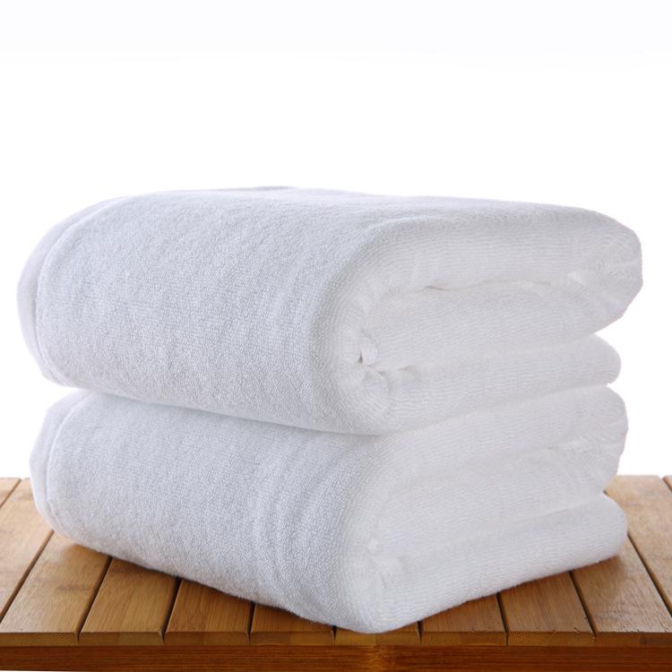 酒店宾馆美容院用的浴巾白色纯棉大加厚家用批發不易掉毛定制logo