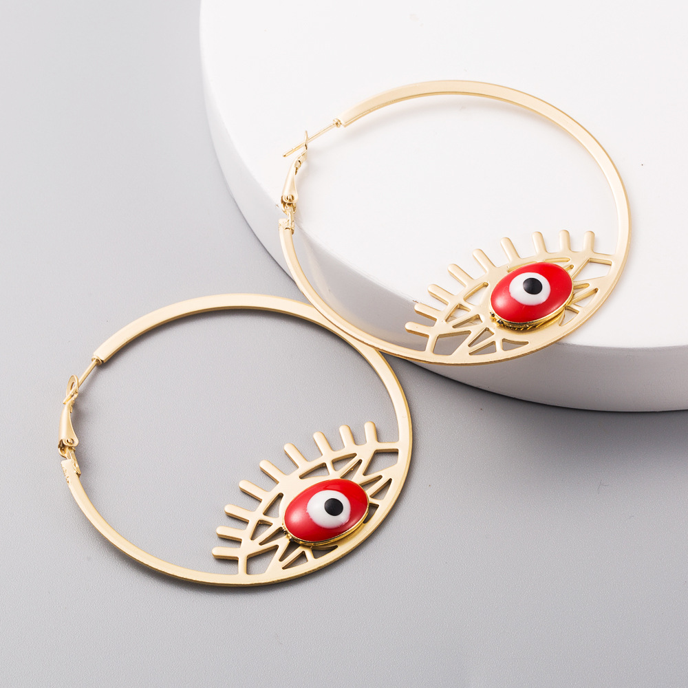 New fashion exaggerated earrings ladies devil's eyes sub-golden drop oil round hollow alloy earrings yiwu nihaojewelry wholesale NHLN208152