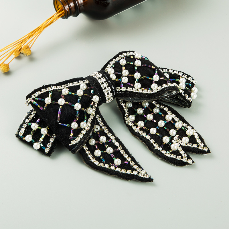 hot-selling fashion  diamond-studded pearl bow hair clip wholesale  NHLN261739