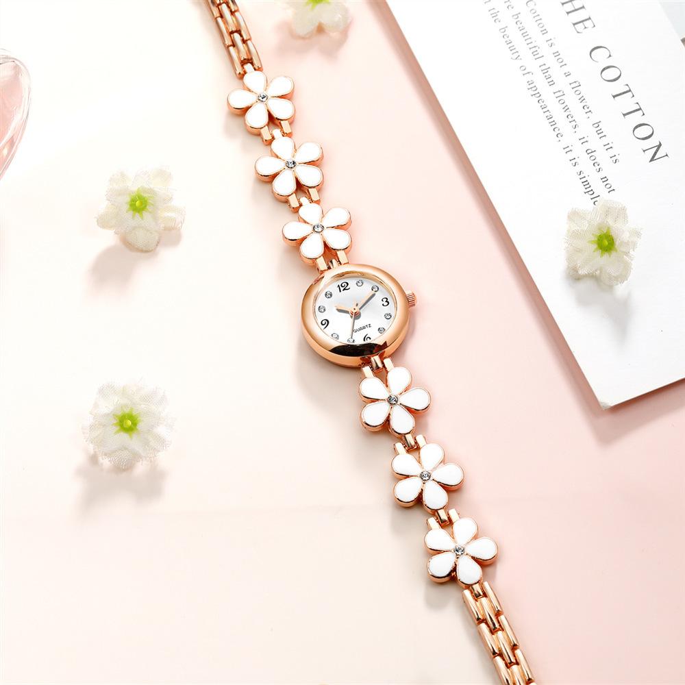 Reloj de pulsera de pétalos de diamantes de moda Reloj de pulsera británico de viento femenino para mujeres universitarias Compacto de viento británico NHSS218495