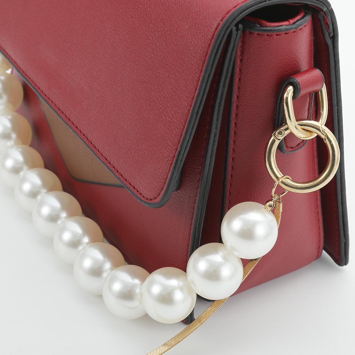 Fashion jewelry personality multi-layer snake bone chain long accessories exaggerated fashion imitation pearl U-shaped tassel bag chain NHXR217215