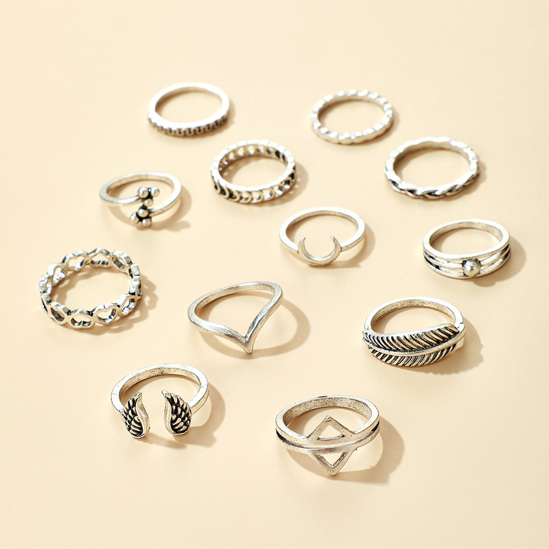 New retro V-shaped totem wings triangle moon love leaf 12-piece ring set wholesale  NHGY244512