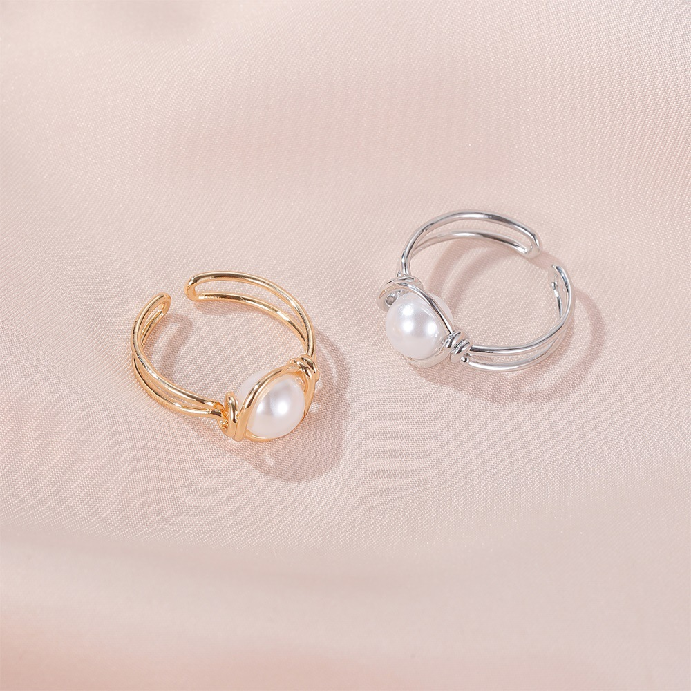 Korean pearl copper rings sweet simple pearl ring knotted mouth ring ladies index finger ring wholesale nihaojewelry NHDP219990