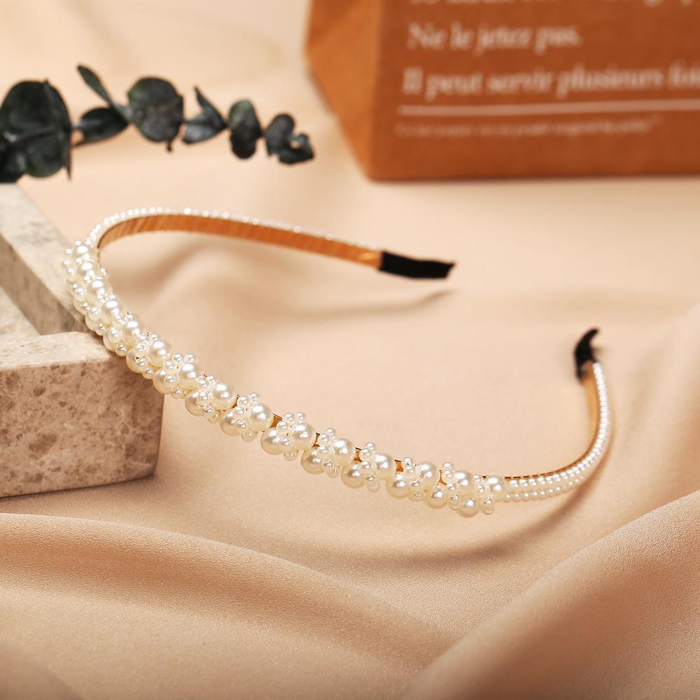 Hot selling faux pearl headband creative retro fashion pearl headband NHYI256898