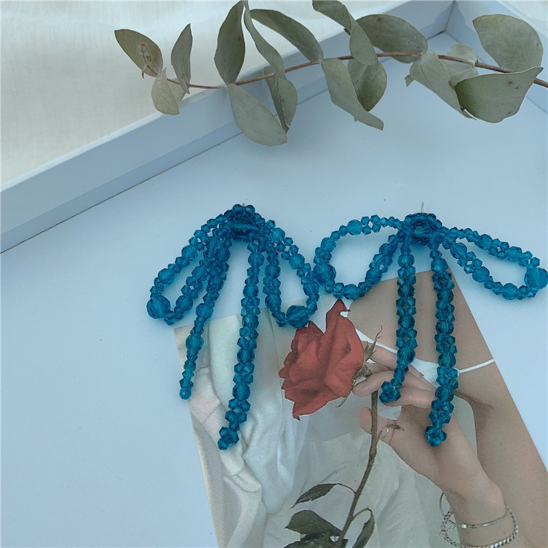 South Koreas new niche handwoven blue crystal beads beads knotted exaggerated earrings wholesale nihaojewelry NHYQ225642