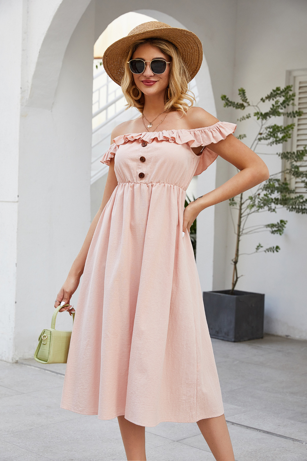 spring and summer new one-line collar stitching ruffled single-breasted solid color dress NSDF511
