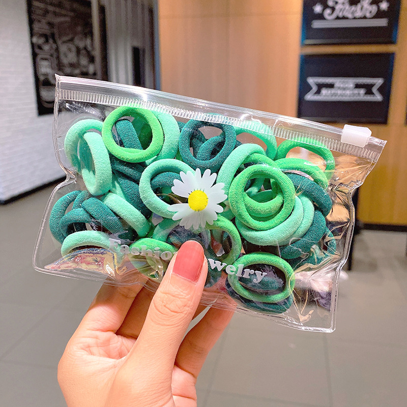 50 small daisy packaging Korean nylon hair ring color towel ring simple fashion head rope hair accessories hair rope wholesale nihaojewelry NHNA223590