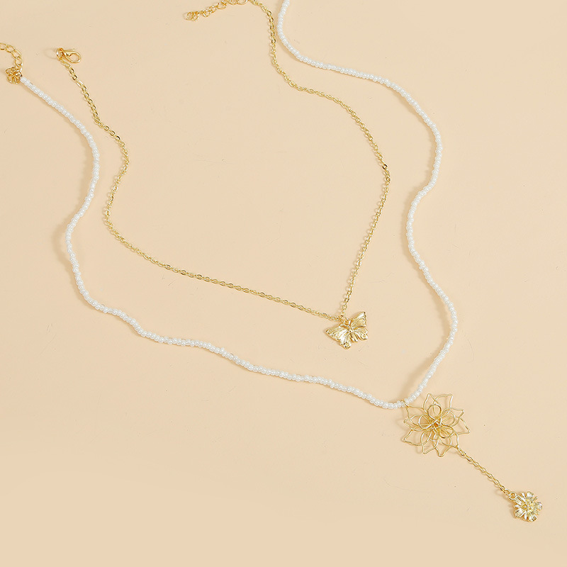 Bohemian flower long rice beads two multilayer necklaces fashion handmade butterfly pendant jewelry wholesale nihaojewelry NHLA229152
