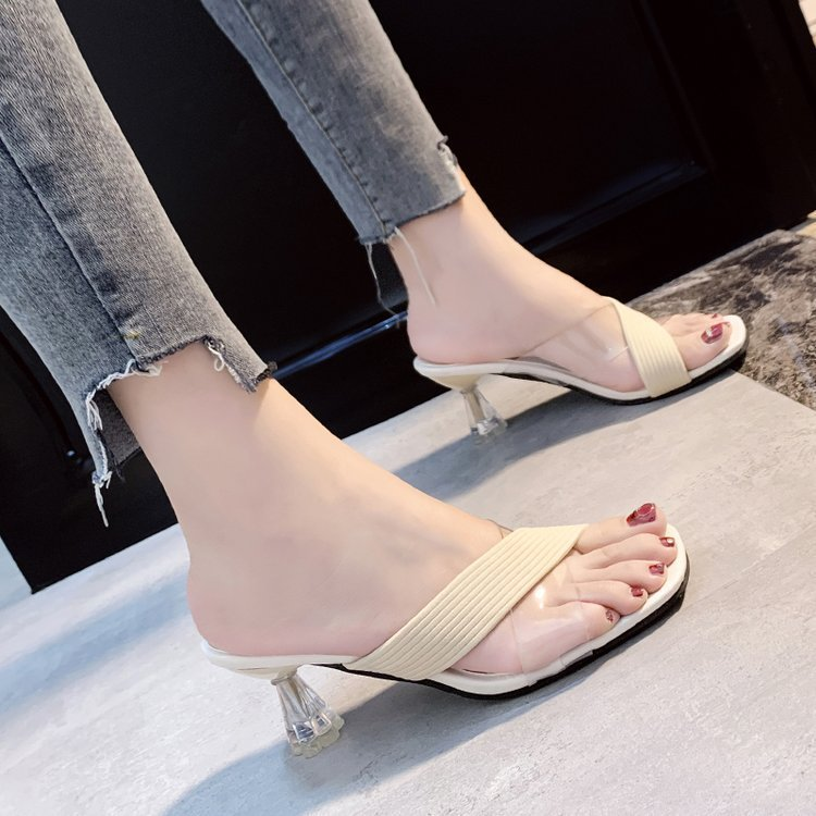 Transparent high-heel sandals and slippe...