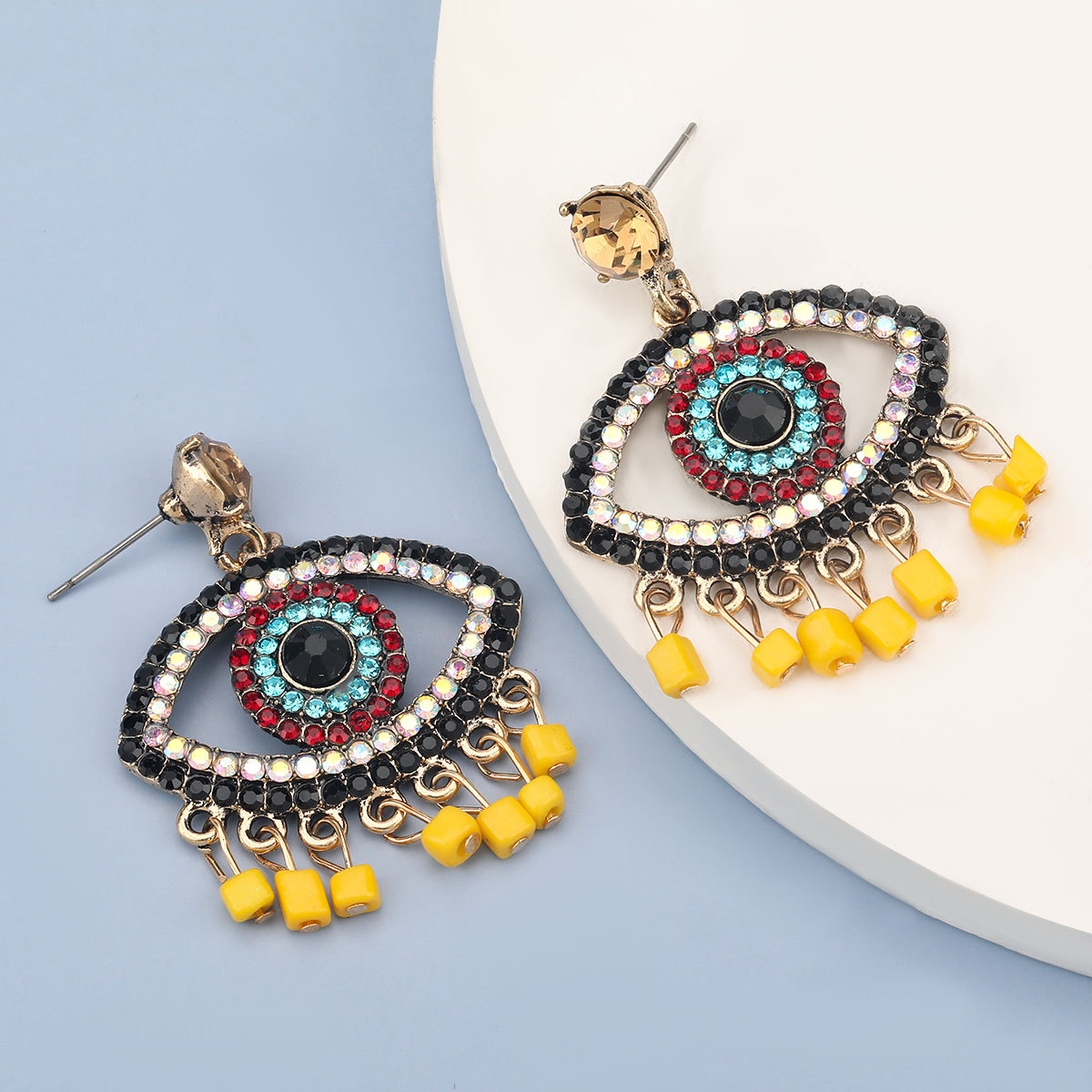 bohemian alloy diamond eyes resin tassel earrings NHJE278888