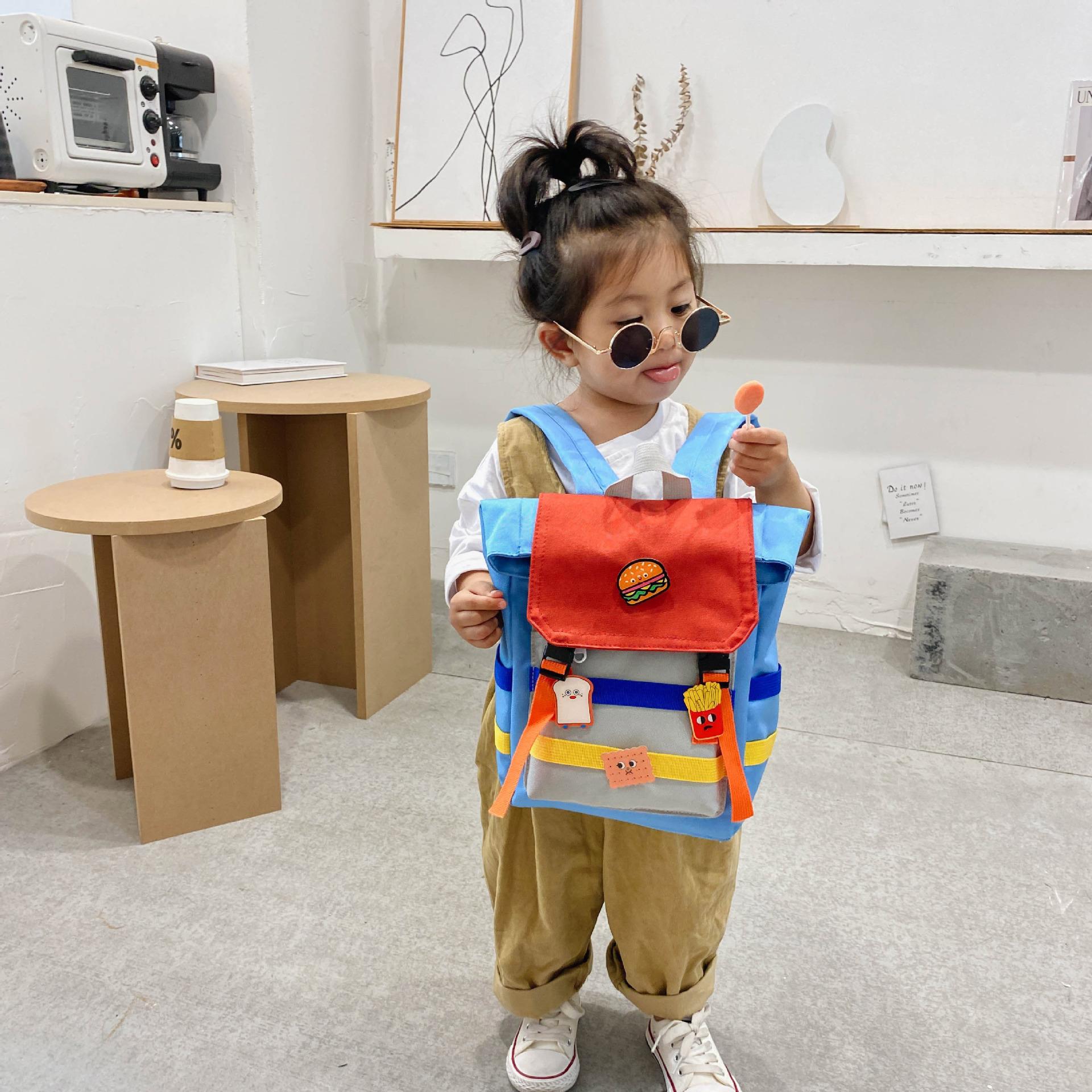 自制新款韩国版勋章DIY儿童男女童撞色幼儿园双肩背小书包包男女