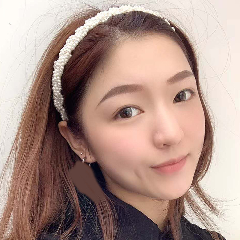 New Korean fashion simple woven pearl ripple knot ladies headband wholesale nihaojewelry NHWJ232306