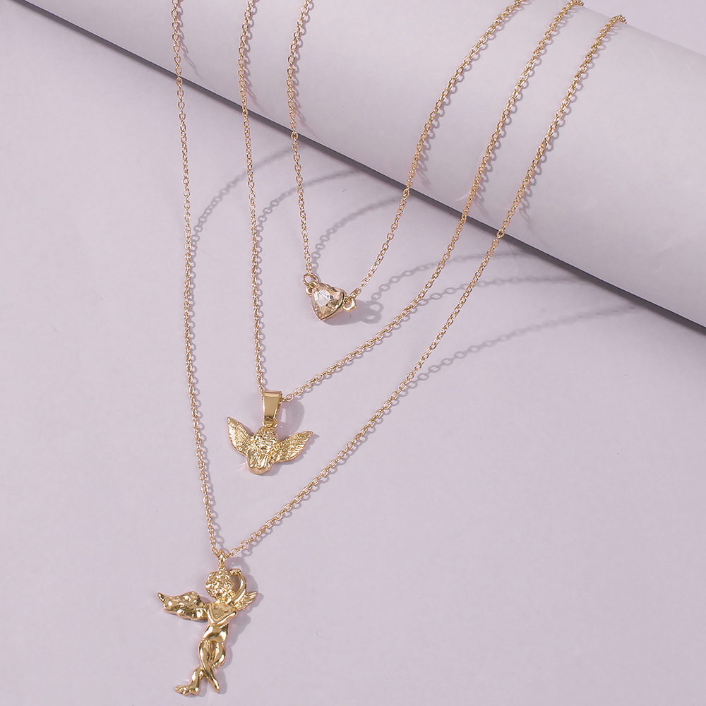 hotselling fashion golden man pendant alloy multilayer hipster clavicle chain necklace for women  NHMD246186