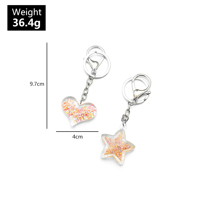 New fashion creative acrylic love keychain accessories peach heart quicksand bag pendant wholesale NHNZ209750