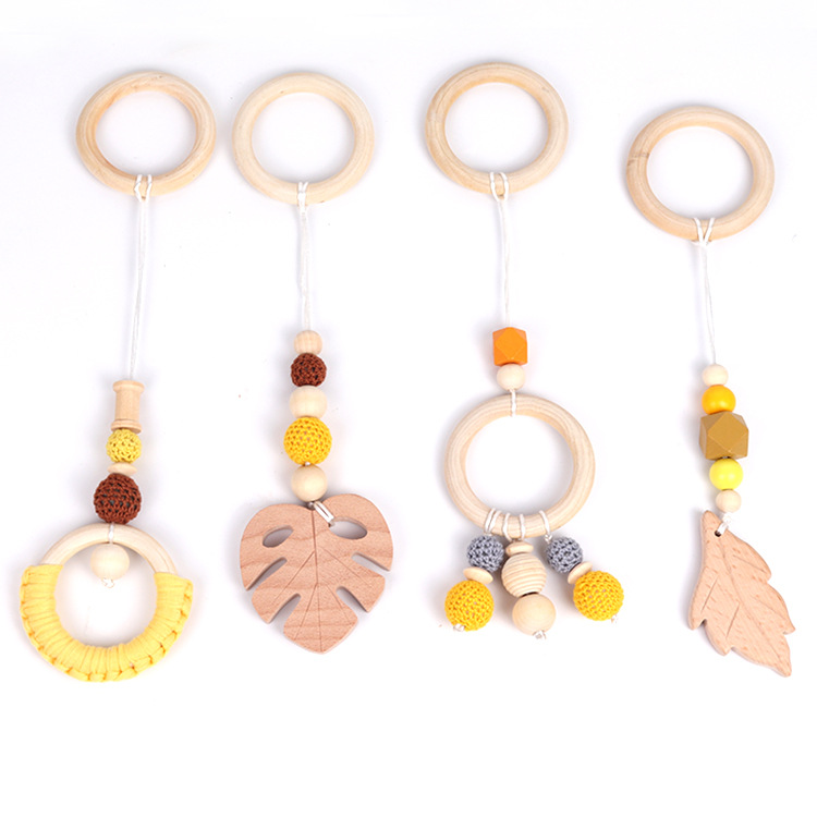 新款毛线珠婴儿房装饰挂件榉木磨牙棒棉布编织木圈牙胶挂件玩具
