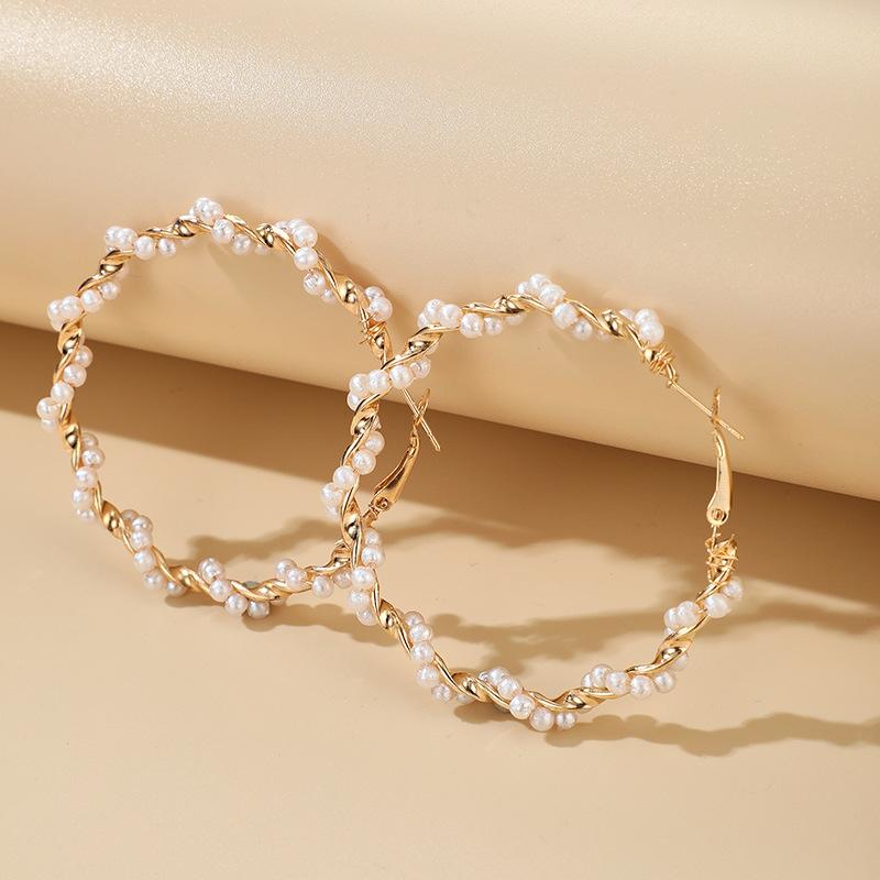Coréen simple spirale perle fille coeur boucles d'oreilles exagérées boucles d'oreilles sauvages en gros nihaojewelry NHGY227760