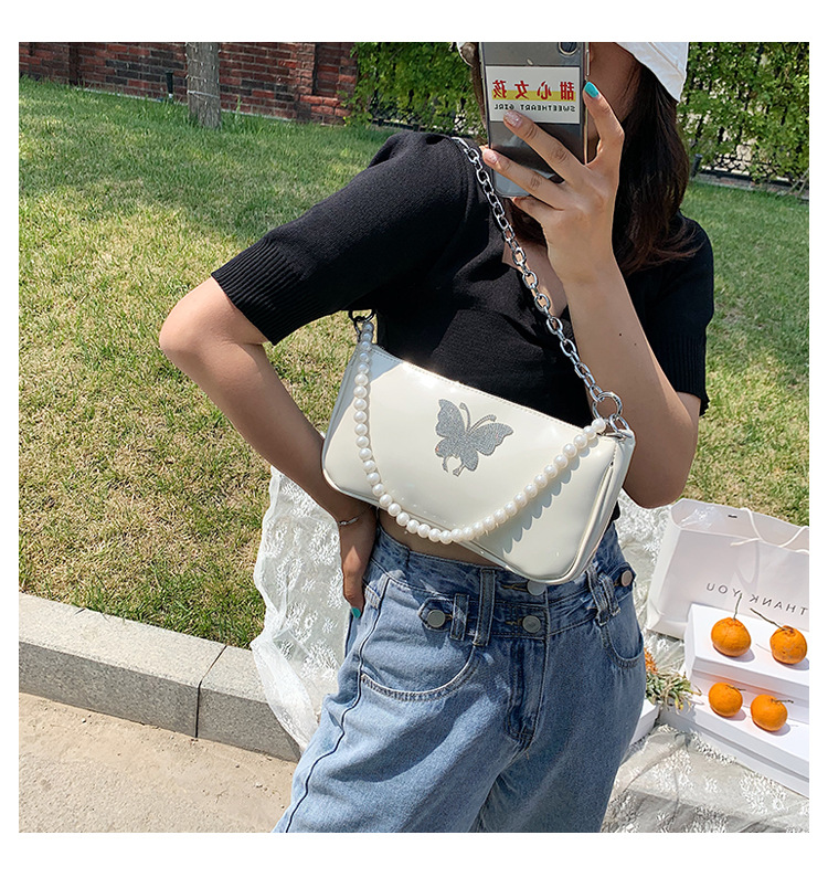 new summer wild shoulder messenger bag female butterfly rhinestone pearl chain portable French stick armpit bag nihaojewelry wholesale NHPB216887
