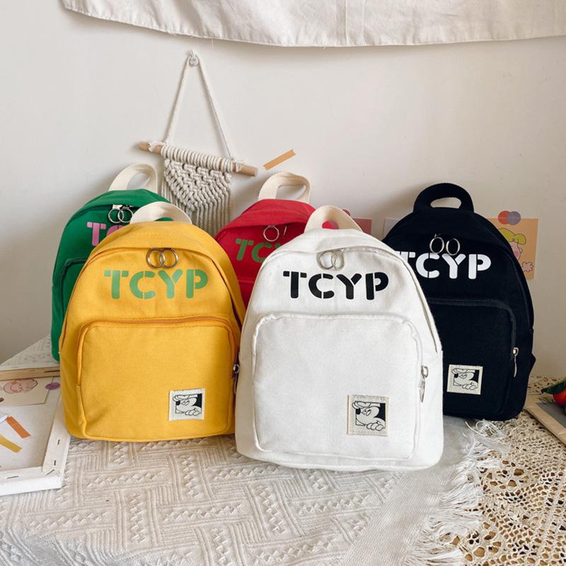 儿童背包2020新款韩版字母帆布双肩包休闲印花幼儿园书包外贸出口