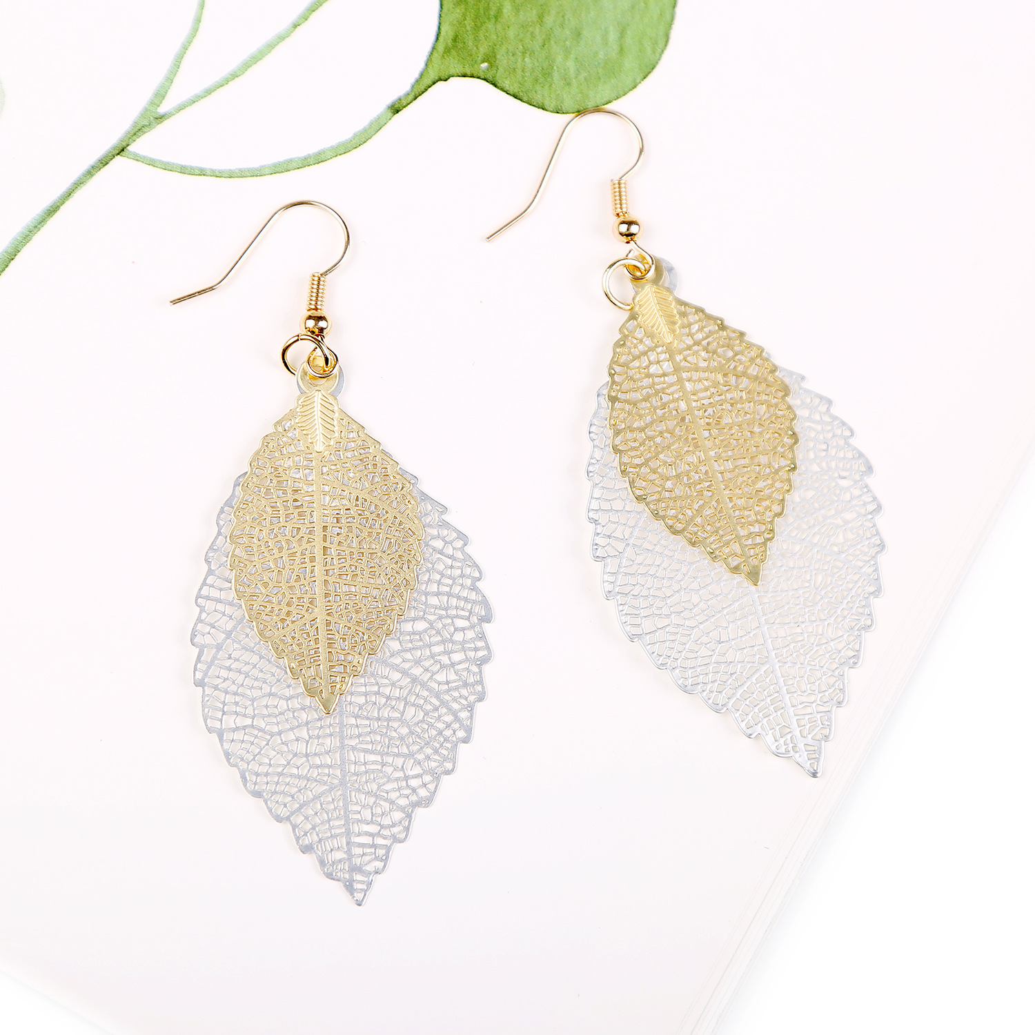 Nihaojewelry Earrings Leaf Earrings Golden Simple Double Cutout Leaf Earrings wholesales fashion NHJJ199347