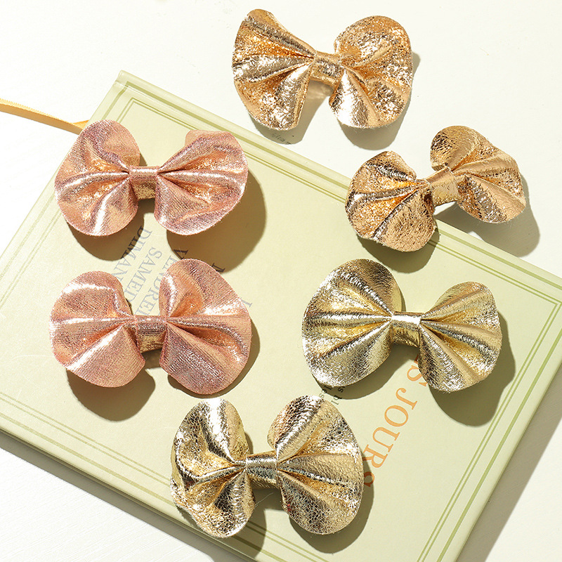 Children's shiny leather bow hairpin  NHNU280602
