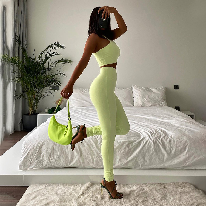 women's solid color pit strip sports yoga two-piece nihaostyles clothing wholesale NSLJ76081