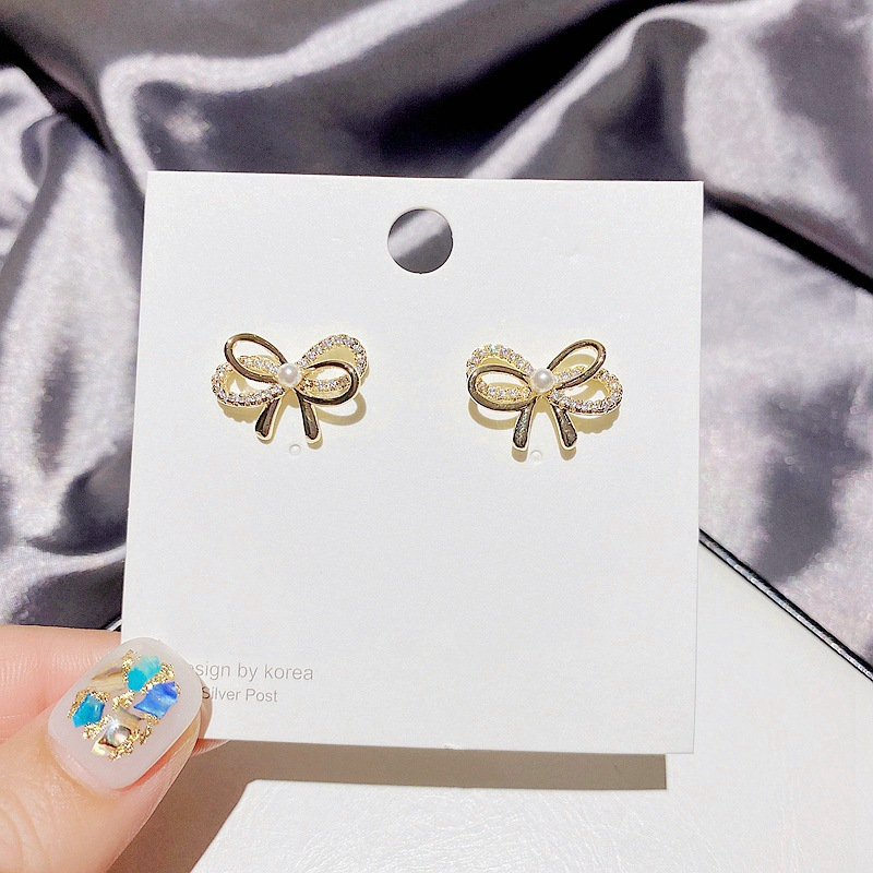 Fashion Multilayer Bow Inlaid Pearl Earrings  NHCG348106