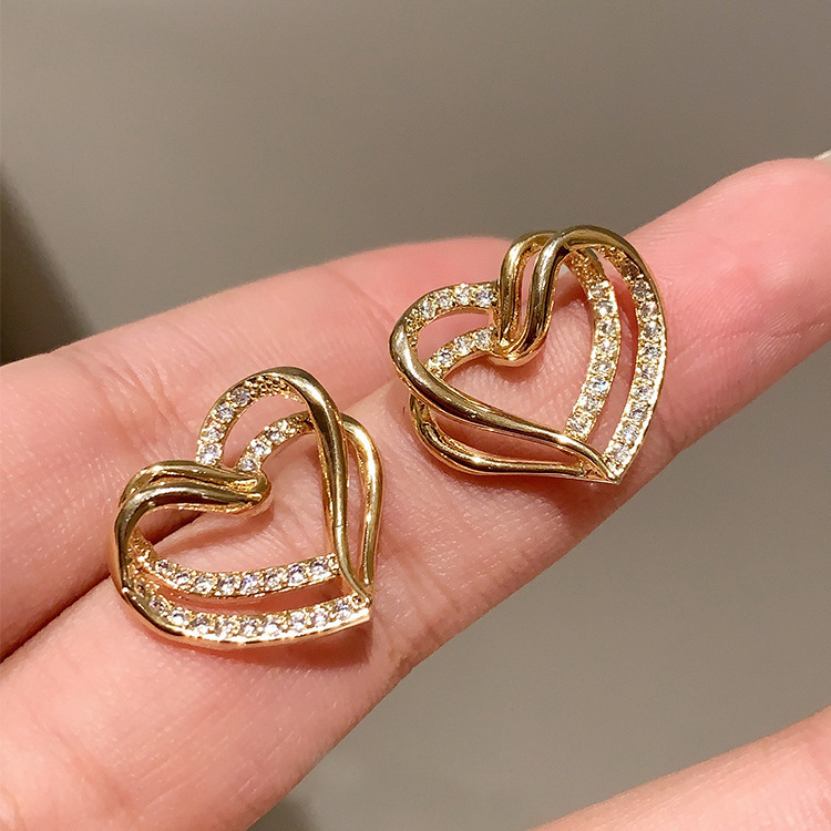 Korean Double Hollow Heart Stud Earrings NHXI357661