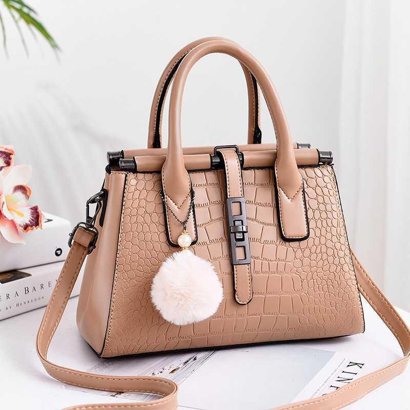 A large-capacity embossed women's bag wi...
