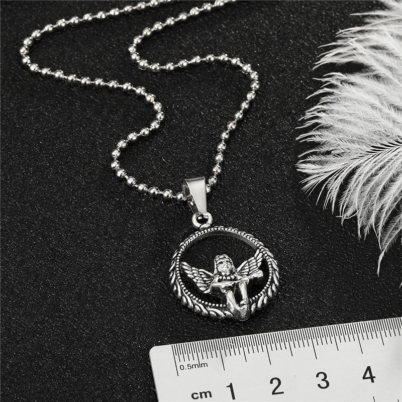 Retro metal cupid hollow round little angel alloy necklace wholesale NHGO348176
