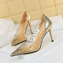 7818-5 European and American Style Sexy metal rivet thin heel high heel shallow mouth pointed transparent diamond splicing hollow single shoe