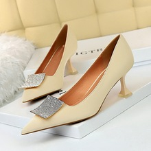 831-1 European and American sexy slim banquet women's shoes cat heel elegant high heel shallow mouth pointed metal water drill button single shoes